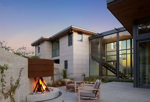 "Contemporary Patio with exterior tile floors, 22"" Fire Twig Sculpture, Gas Fire Pit Stones, Fire pit, French doors"