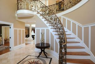 Traditional Entryway with Wainscotting, complex marble tile floors, High ceiling