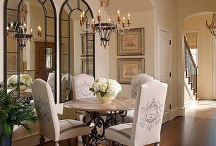 Traditional Dining Room with Paint, Chandelier, Crown molding, High ceiling, Hardwood floors, six panel door
