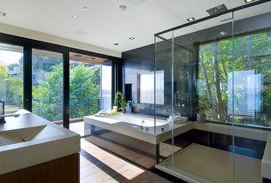 Contemporary Master Bathroom with Master bathroom, Double sink, Balcony, limestone tile floors, French doors, Undermount sink