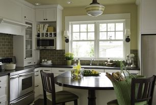 Contemporary Kitchen with L-shaped, Standard height, Flat panel cabinets, Undermount sink, can lights, double-hung window