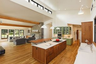 Contemporary Great Room with Wall sconce, High ceiling, Hardwood floors, Built-in bookshelf, Pendant light, Exposed beam