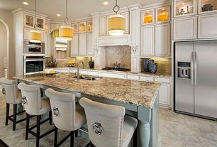 Traditional Kitchen with slate tile floors, Custom hood, High ceiling, flush light, European Cabinets, Travertine Tile