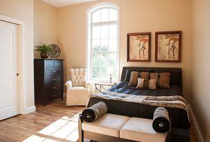 Modern Guest Bedroom with Arched window, specialty door, Hardwood floors