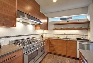 Contemporary Kitchen with Destiny: slab cabinets, Sandstone counters, Dupont - Corian Pebble, European Cabinets, L-shaped