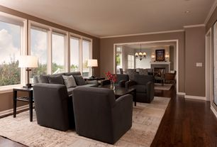 Contemporary Living Room with Casement, Crown molding, Hardwood floors, Standard height, can lights
