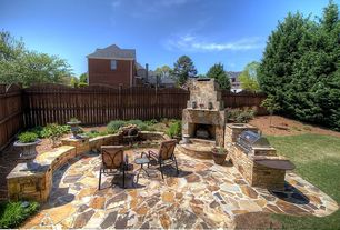 Rustic Patio with exterior stone floors, Outdoor kitchen, Outdoor fireplace, Fence, Pathway