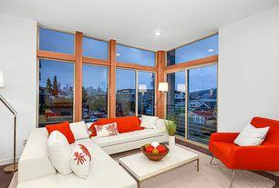 Modern Living Room with Hardwood floors, picture window, can lights, Transom window, Standard height, sliding glass door