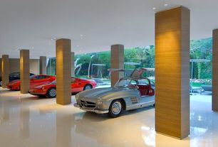 Contemporary Garage with sliding glass door, Columns, Standard height, Laminate floors, can lights, picture window