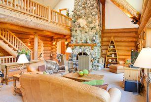 Rustic Great Room with Columns, stone fireplace, Pendant light, Built-in bookshelf, Fireplace, Carpet, Loft