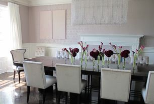 Traditional Dining Room with Hardwood floors, Crown molding, interior wallpaper, Wainscotting, Chandelier