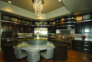 Art Deco Kitchen with Simple granite counters, wall oven, Flush, double oven range, Glass panel, full backsplash, U-shaped