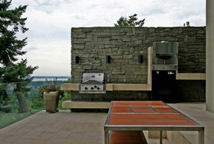 Rustic Patio with Outdoor kitchen, exterior stone floors, Fence