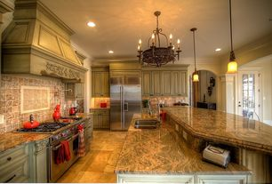 Traditional Kitchen with can lights, High ceiling, French doors, Custom hood, Kitchen island, travertine tile floors