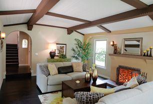 Modern Living Room with Wall sconce, Hardwood floors, Built-in bookshelf, Exposed beam