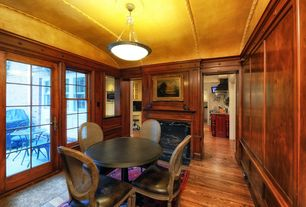 Traditional Dining Room with insert fireplace, Hardwood floors, flush light, Standard height, French doors, Fireplace