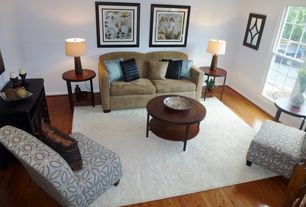 Contemporary Living Room with double-hung window, Standard height, Hardwood floors