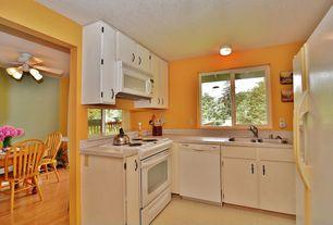 Traditional Kitchen with Casement, gas range, Standard height, partial backsplash, dishwasher, built-in microwave, U-shaped