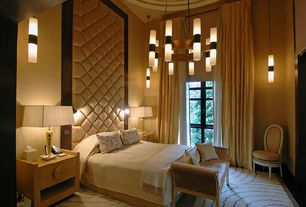 Contemporary Master Bedroom with Standard height, specialty window, Built-in bookshelf, Pendant light, Carpet
