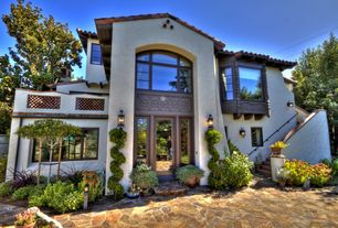 Mediterranean Exterior of Home with French doors, Fence, Arched window, Daltile slate collection mongolian spring flagstone