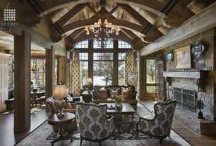 Country Living Room with Chandelier, stone fireplace, Built-in bookshelf, Transom window, Oriental area rug, High ceiling