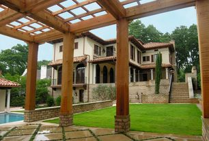Mediterranean Landscape/Yard with Fence, French doors, Arched window, Pathway, Transom window, Trellis, Raised beds