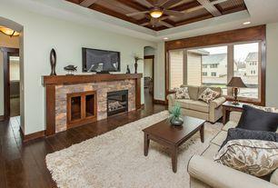 Craftsman Living Room with Built-in bookshelf, Exposed beam, Ceiling fan, Hardwood floors, flush light, stone fireplace