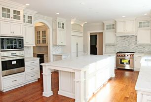 Traditional Kitchen with Marble backsplash, Crown molding, Glass panel, Wine refrigerator, Kitchen island, Undermount sink