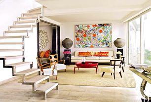 Eclectic Living Room with Standard height, sliding glass door, Hardwood floors, Exposed beam