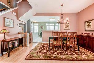 Craftsman Dining Room with Chandelier, flush light, picture window, Hardwood floors, Standard height, Built-in bookshelf