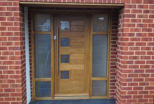 Contemporary Front Door with exterior stone floors, Glass panel door