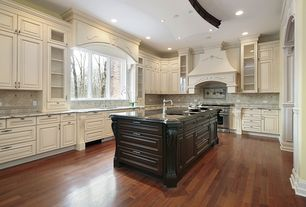 Traditional Kitchen with Standard height, Flush, Complex granite counters, dishwasher, can lights, Custom hood, Paint 1