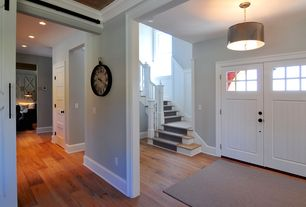 Country Entryway with French doors, Standard height, Hardwood floors, Pendant light