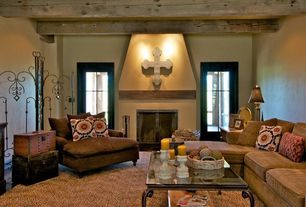 Country Living Room with Cement fireplace, Exposed beam, French doors, Concrete floors