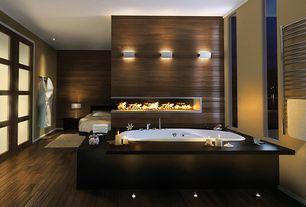 Contemporary Master Bathroom with Standard height, Hardwood floors, Bathtub, drop in bathtub, can lights, Paint 1, Fireplace