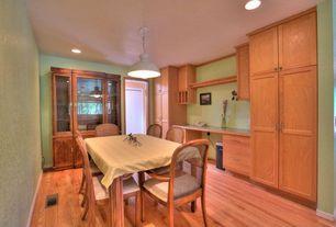 Craftsman Dining Room with Built-in bookshelf, Standard height, Hardwood floors, flush light, can lights