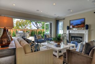 Contemporary Living Room with Indoor/outdoor living, Carpet, Crown molding, stone fireplace