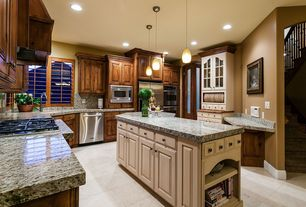 Traditional Kitchen with stone tile floors, Undermount sink, Custom hood, limestone tile floors, U-shaped, Complex Granite