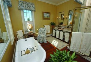 Traditional Full Bathroom with Hardwood floors, Wall sconce, Undermount sink, Crown molding, Clawfoot, Double sink