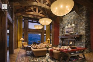 Rustic Great Room with Natural stone wall, Loft, flush light, Exposed beam, Hardwood floors, French doors, Columns