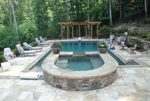 Traditional Swimming Pool with Raised beds, exterior stone floors, Fence, Pool with hot tub, Trellis
