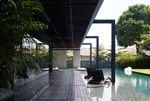 Contemporary Swimming Pool with Lap pool, Fence, Glass panel door