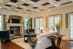 Traditional Living Room with Hardwood floors, French doors, Box ceiling, Cement fireplace, Wainscotting