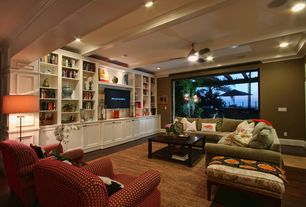 Traditional Living Room with Hardwood floors, Built-in bookshelf, can lights, Standard height, Exposed beam, Ceiling fan