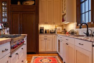 Country Kitchen with European Cabinets, Limestone Tile, Gas stove, Kitchen island, Undermount sink, Stone Tile, L-shaped