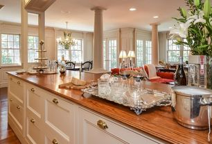 Traditional Bar with French doors, Built-in bookshelf, Hardwood floors, Crown molding, Columns