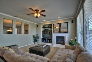 Traditional Living Room with Ceiling fan, insert fireplace, Tufted sectional, Fireplace, Carpet, Standard height, Paint 1