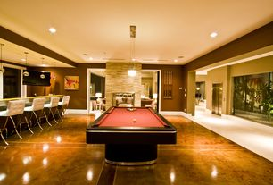 Contemporary Game Room with Laminate floors, Pendant light