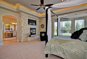 Traditional Master Bedroom with stone fireplace, sliding glass door, Vanity, wall-mounted above mirror bathroom light, Carpet