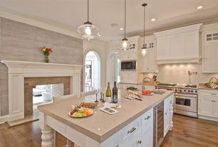 Traditional Kitchen with Silestone quartz countertop in capri limestone, Crown molding, Kitchen island, Pendant light